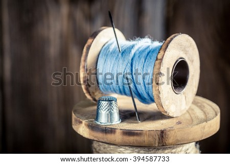 Closeup of vintage needle and threads - stock photo