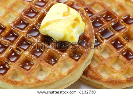 Closeup of waffles with syrup and butter. - stock photo