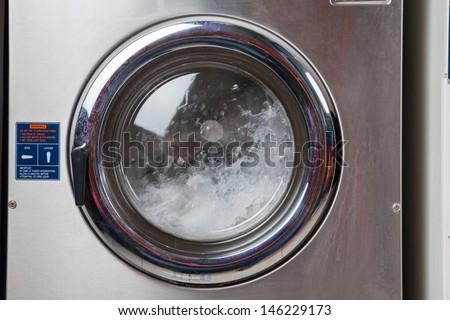 Closeup of water spinning in washing machine - stock photo
