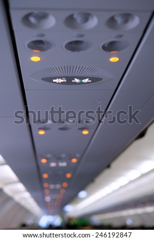 Closeup of wear the seatbelt signage inside the aircraft - stock photo