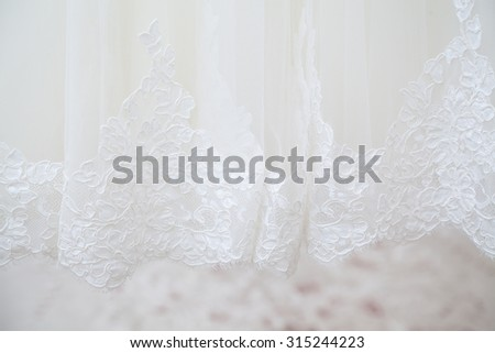 Closeup of wedding dress embroidery - stock photo