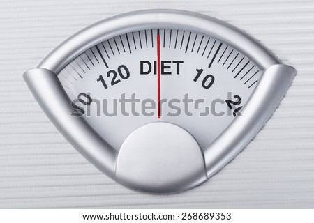 Closeup of weight scale indicating Diet word - stock photo