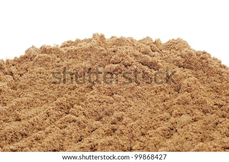 closeup of wet sand on a white background - stock photo