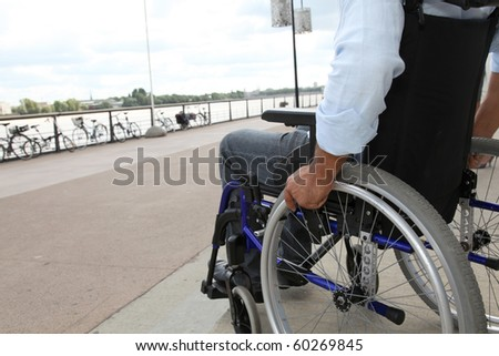 Closeup of wheelchair - stock photo