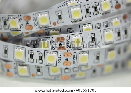 Closeup of white LED strip with SMD components - stock photo