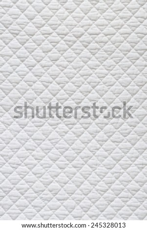 Closeup of white quilted fabric - stock photo