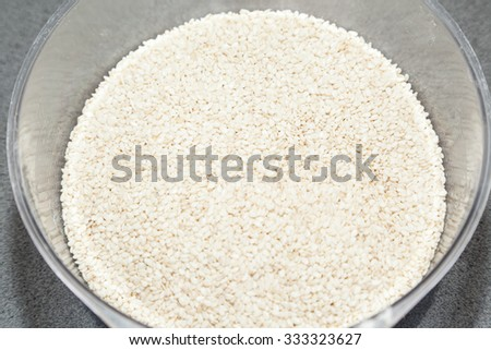 Closeup of white sesame seed kernels - stock photo