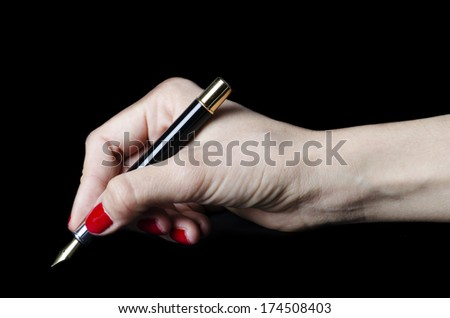 Closeup of woman hand holding pen on notebook isolated on black background - stock photo