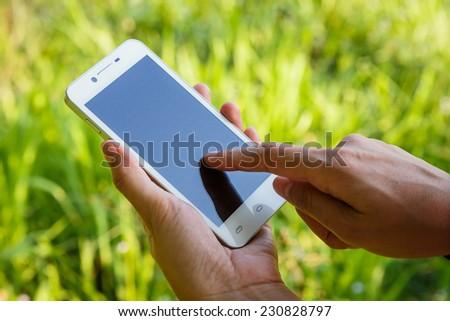 Closeup of woman hands using smartphone - stock photo