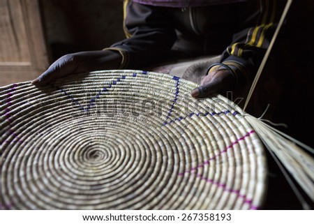 closeup of woman's hands holding handmade basket in Ethiopia - stock photo
