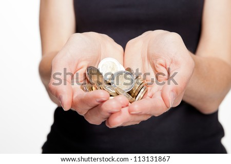 Closeup of woman's hands showing coins:white background - stock photo