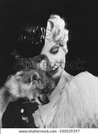 Closeup of woman with dog - stock photo