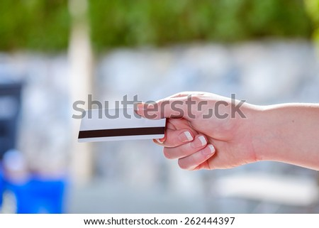 Closeup of women holding credit card - stock photo