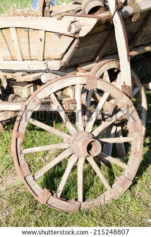 Closeup of wooden cart with wheel  - stock photo