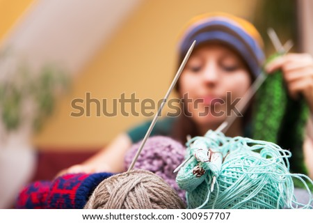 closeup of wool with a woman in the background - stock photo