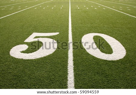 Closeup of 50 yard line on American football field. - stock photo