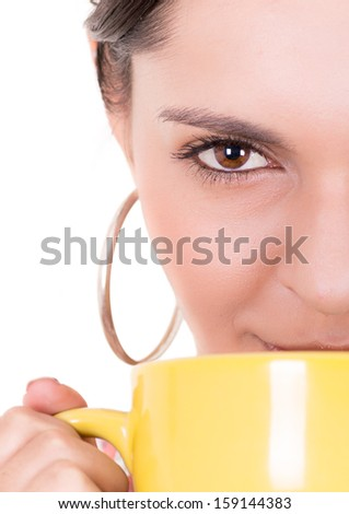Closeup of yellow cup and a woman face - stock photo