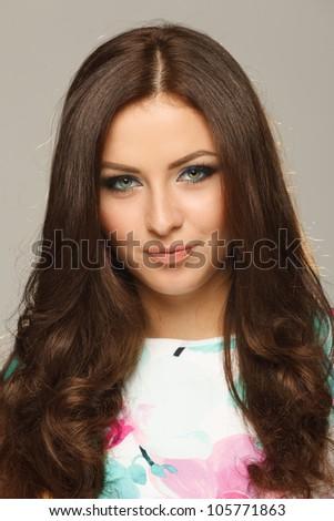 Closeup of young beautiful brunette - stock photo