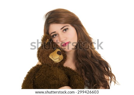 Closeup of Young beautiful girl holding teddy bear isolated on white - stock photo