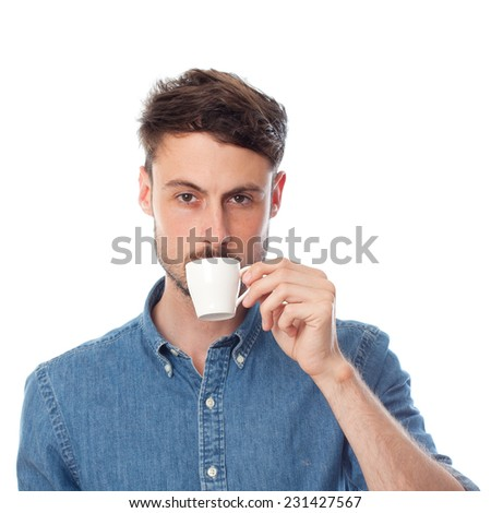 closeup of young cool man taking coffee - stock photo