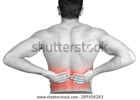 Closeup of young shirtless man with back pain over white background - stock photo