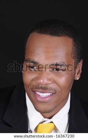 closeup of young smiling African American businessman - stock photo