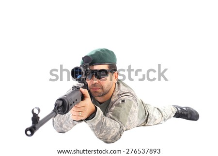 Closeup of young soldier or sniper aiming with a rifle isolated on white background - stock photo