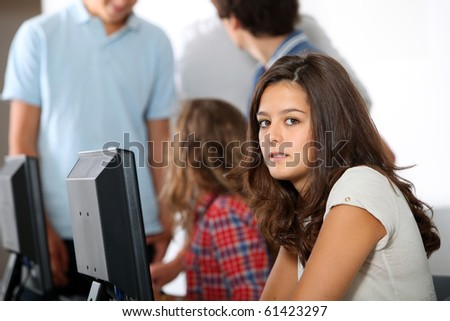 Closeup of young student sitting in class - stock photo