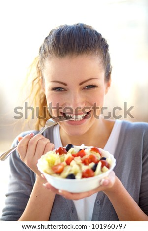 Closeup of young woman eating healthy food - stock photo