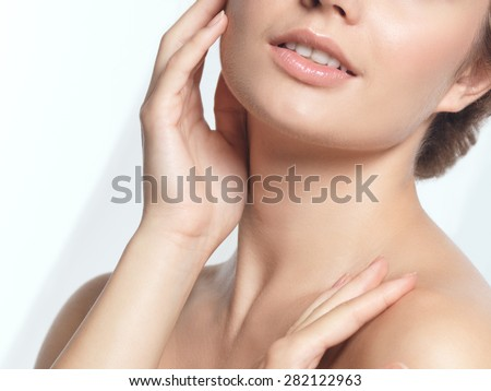 Closeup of young woman face beauty portrait with natural look  - stock photo