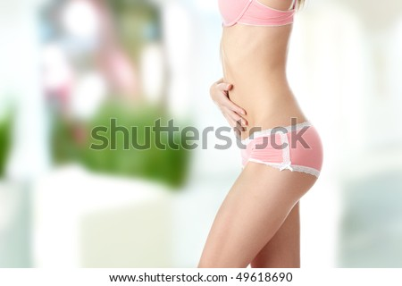 Closeup of young woman with hand on her stomach isolated - stock photo