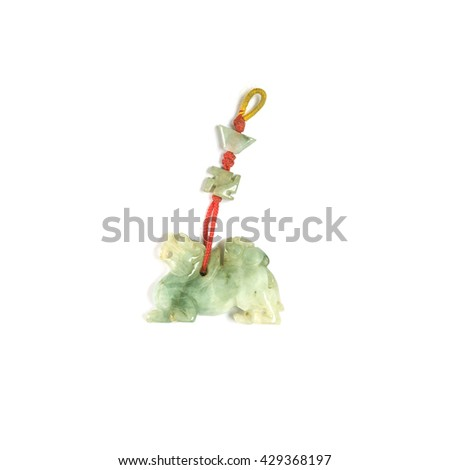 Closeup old green jade amulet for good fortune isolated on white background - stock photo