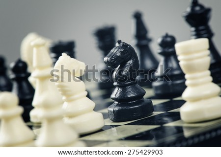 closeup old mini chess on chessboard - stock photo