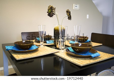Closeup On A Setup Dinner Table In A Kitchen - stock photo