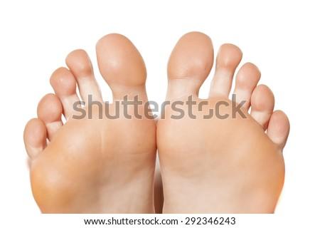 Closeup on bare female feet - stock photo