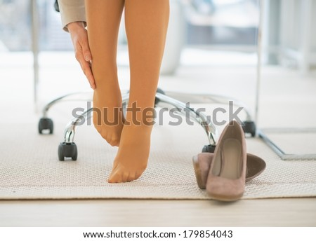 Feet And Shoes Of Businesswoman In Office Stock Photos