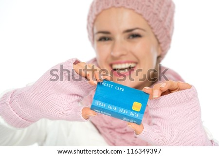 Closeup on credit card in hand of woman in winter clothing - stock photo