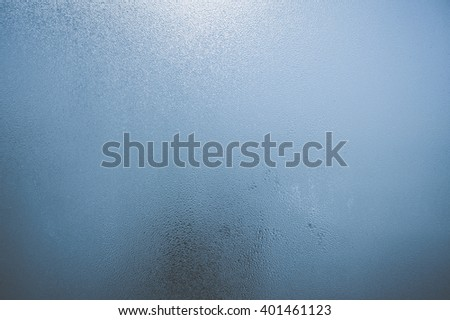 Closeup on fog condensation on window glass background - stock photo