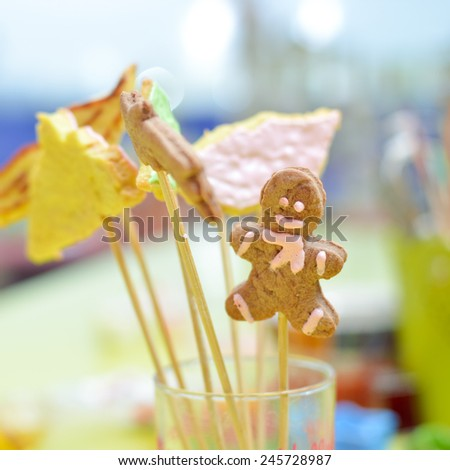 closeup on gingerbread cookies on stick in glass - stock photo
