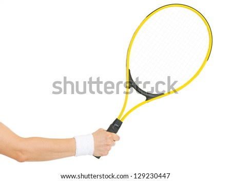 Closeup on hand with tennis racket - stock photo