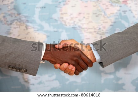 Closeup on international business handshake - stock photo