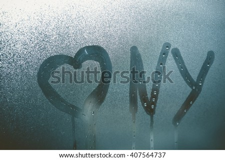 Closeup on Love heart NY - New York sign on glass background - stock photo