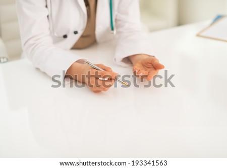 Closeup on medical doctor woman explaining - stock photo