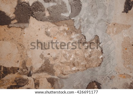 Closeup on old wall plaster during refurbishment process, gray background surface - stock photo