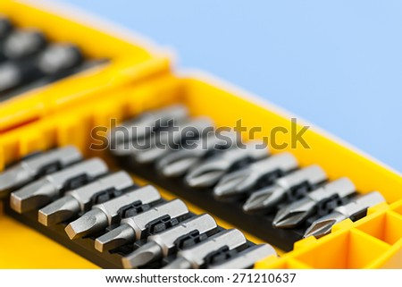 Closeup on phillips and robertson screwdriver insert bits of various sizes - stock photo