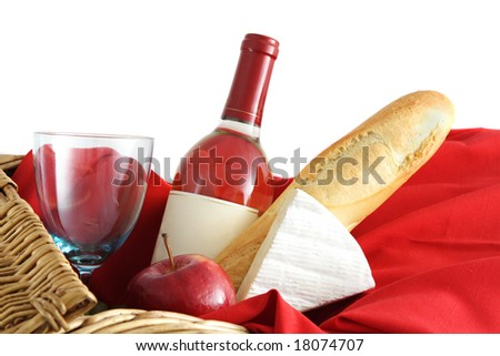 closeup on picnic basket food and wine - stock photo