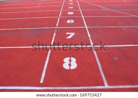 Closeup on running track start line - stock photo