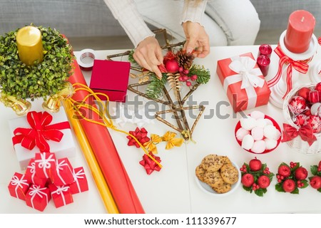 Closeup on table where woman making Christmas decorations. Upper view - stock photo