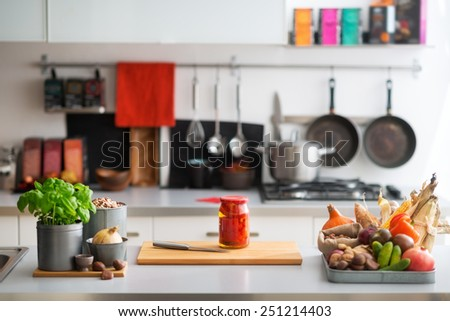 Closeup on table with vegetables in kitchen - stock photo