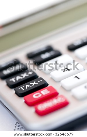 Closeup on tax calculator keypad with red black and white buttons - stock photo